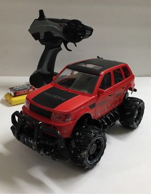 New in box 1:24 scale RC radio control range rover red and black color car suv offroad truck rechargeable battery included for Sale in Los Angeles, CA
