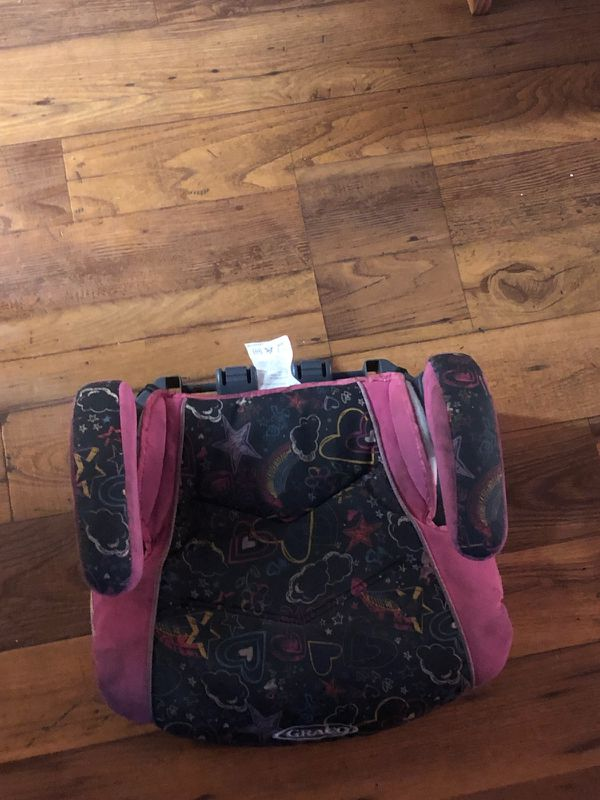 Baby pink and black booster seat