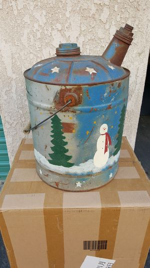 Vintage oil can christmas decoration and decorative garden planter for Sale in Buena Park, CA