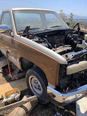 Parting out 1990 gmc has towing package 14 bolt 6 lug rear axle good wheels bumpers No engine and trans sold for Sale in San Jose, CA