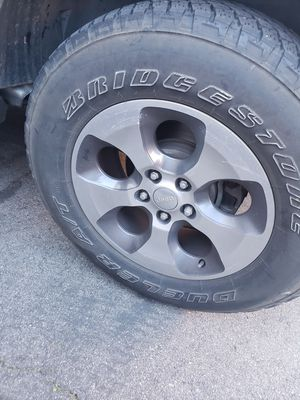 Jeep tires and rims good condition for Sale in Riverside, CA