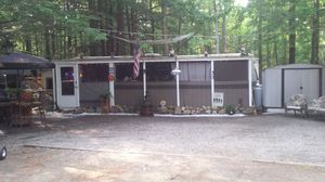 38 ft sandpiper camper with a 38 ft screened in porch golf cart included for Sale in Waltham, MA