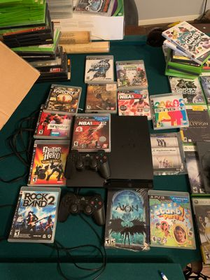 PlayStation 3 with 2 wireless controllers 10 games for Sale in Katy, TX
