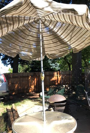 Glass table with umbrella for Sale in Vancouver, WA