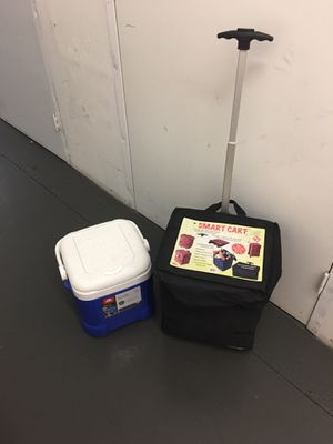 Smart cart with wheels and extendable handle, cooler fits perfectly inside ( you can bungee cord a chair to the handle for easy travel for Sale in Huntington Beach, CA