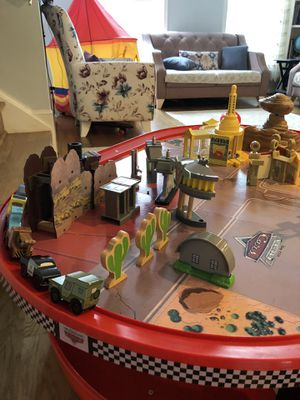 KidKraft Disney Cars Radiator Springs Race Track Set and Table for Sale in Clifton, VA