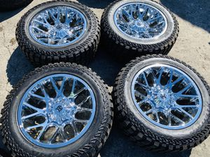 20x10 Chrome rims and Mud RT tires 5 lug Dodge Ram and Toyota Tundra for Sale in Modesto, CA