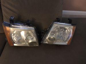2005 Nissan Xterra head lights for Sale in Aloma, FL