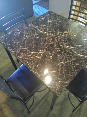 Table and four chairs for Sale in Phoenix, AZ