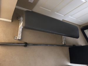 Olympic straight bar, preacher curl bench, flat bench, and iron plates for Sale in Aurora, CO