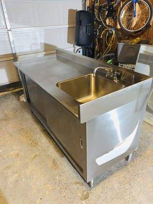 NEW STAINLESS SINK WITH FAUCET,DRAIN AND ENCLOSED STORAGE WITH SLIDING DOORS for Sale in Blacklick, OH