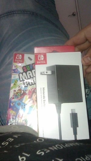 NINTNEDO SWITCH CHARGER WITH FREE SUPER MARIO PARTY for Sale in Peoria, AZ
