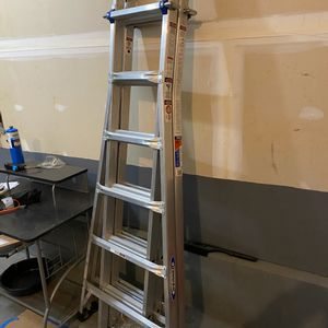WERNER 26 ft. Reach Alluminum Telescoping Multi-Position Ladder with 300lbs Load Capacity for Sale in Jackson, NJ
