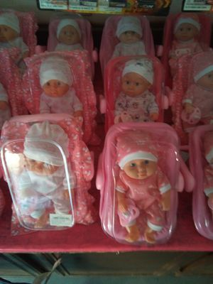 Mini baby dolls with car seat and pacifier located in Palmdale California 4 for $17 for Sale in Palmdale, CA