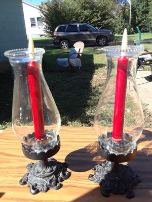 CAST IRON candle holders with the battery candles for Sale in Leon, KS