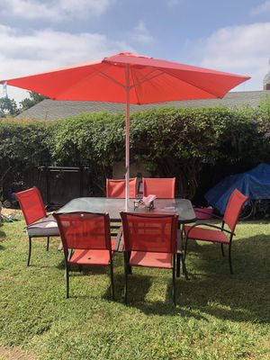 1 Glass Table and 6 chairs with new umbrella for Sale in Rancho Cucamonga, CA