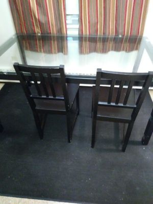 Nice black glass table come with three chairs from Ikea paid 350 asking 125 for Sale in Cleveland, OH