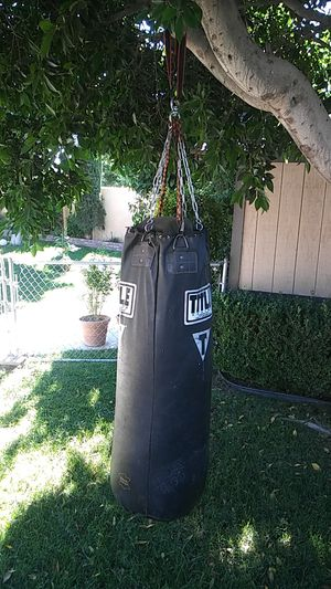 TITLE. Heavy punching bag for Sale in Riverside, CA