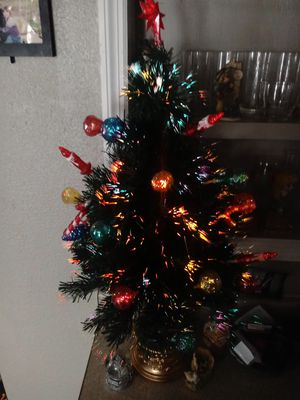 Beautiful Pre-Lit 3 foot Christmas tree. Built in ornaments for Sale in Hannibal, MO