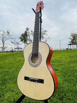 38 in Light weight student Acoustic guitar in natural wood for Sale in South Gate,  CA