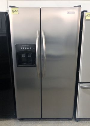 Comes with free 6 Months Warranty-26 cu. ft. Side by side refrigerator stainless steel Frigidaire for Sale in Detroit, MI