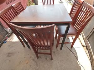 BEAUTIFUL TALL WOOD TABLE WITH METAL LEGS AND 6 HEAVY TALL WOOD CHAIRS NEW SEATING, IN EXCELLENT CONDITION $170 NEGOTIABLE for Sale in Bakersfield, CA