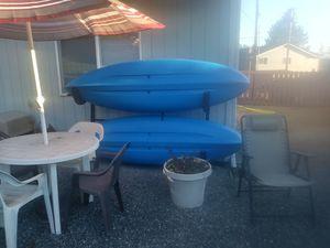 2new kayaks plus upright storage rack for Sale in Lake Stevens, WA