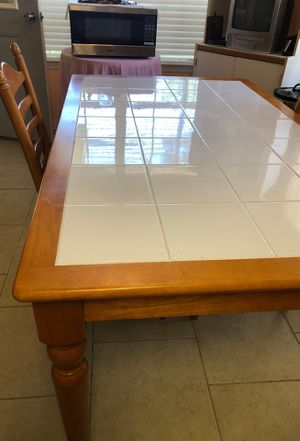 Wooden Kitchen Table with ceramic tile. Seats 4 has 4 wooden chairs that is included. for Sale in Pensacola, FL