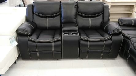 Sofa and love seat with cop holders recliner spots, made of leather, black color(doesn't includes the coffee table) for Sale in Midvale,  UT