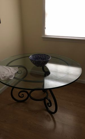Small dining room table great for an eat in kitchen easy to move glass is thick and sturdy and comes right off for Sale in Morristown, NJ