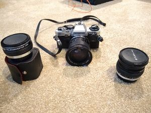 OLYMPUS OM-10 35MM SLR FILM CAMERA WITH ROKINON TELECONVERTER AND 2 LENSES for Sale in Frisco, TX