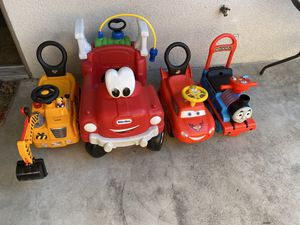 Little tikes play house and 4 ride on toys $200 for Sale in Hemet, CA
