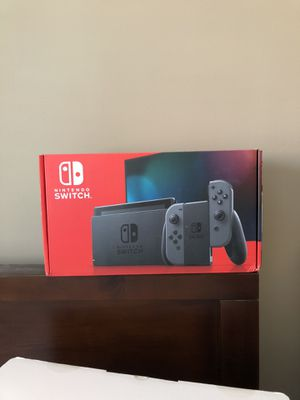 Nintendo Switch with Gray Joy Con - New for Sale in Atlanta, GA