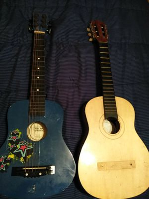 One is a First Act discovery and the other is The Santa Rosa Folk Guitar Company K55 for Sale in Knoxville, TN