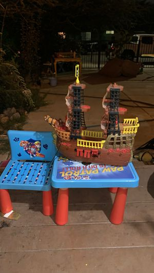 Toys kids table with chair and a ship for Sale in Rancho Cucamonga, CA