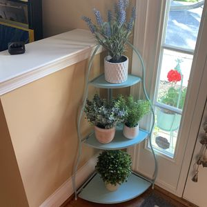 Table with Four potted flowers (artificial) for Sale in Clarksburg, MD