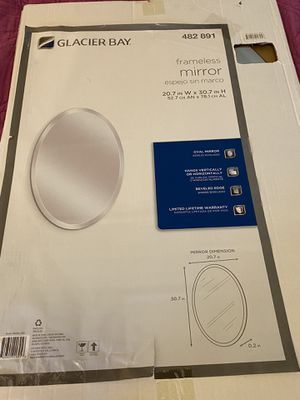 New glaciar bay frameless oval mirror for Sale in Sykesville, MD