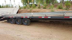 3 axle gooseneck trailer with dove tail and ramps for Sale in Hemet, CA