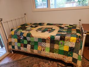 Twin bed Metal... $150. Quilt not for sale. for Sale in Portland, OR
