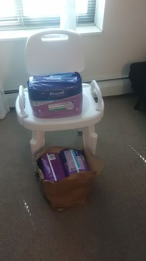 Chair and diapers for Sale in Champlin, MN