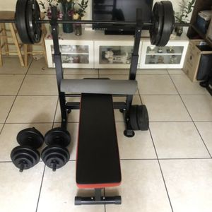 Bench Press with 150 Lbs of Weights Like New for Sale in Miami, FL