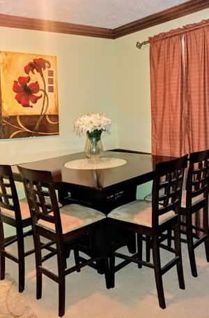 Beautiful Dining Table with Lazy Susan and Wine Storage for Sale in Lithonia, GA