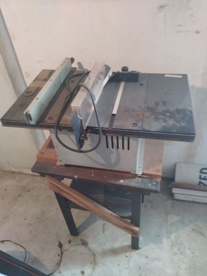 Chainsaw and table includes 2 new blades for Sale in Detroit, MI