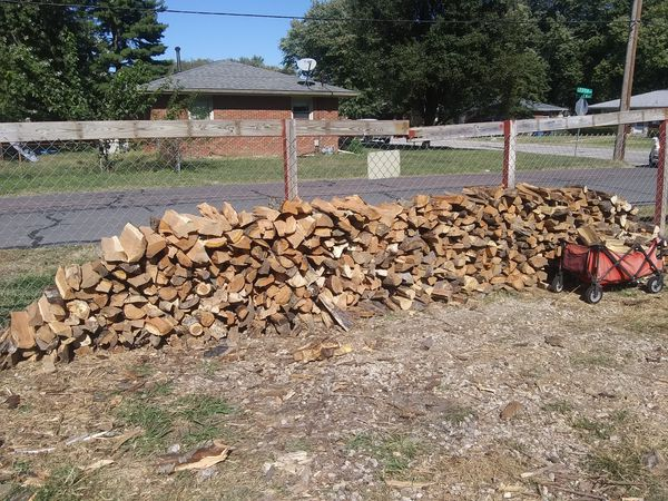 A truck load of Seasoned firewood deliver and stack