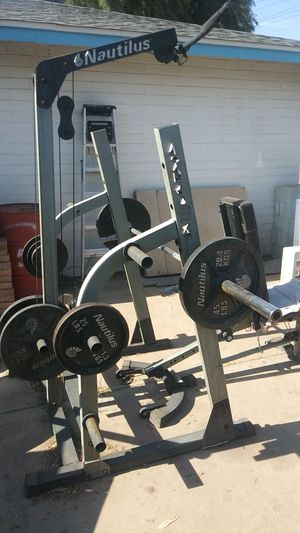 Weight set with curl bar bench press and rack with 250+ pounds of weight plates for Sale in Phoenix, AZ