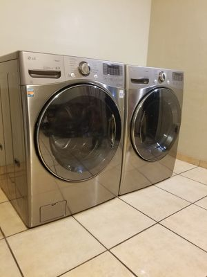 LG STAINLESS STEEL LG WASHER AND GAS STEAM DRYER for Sale in Glendale, AZ