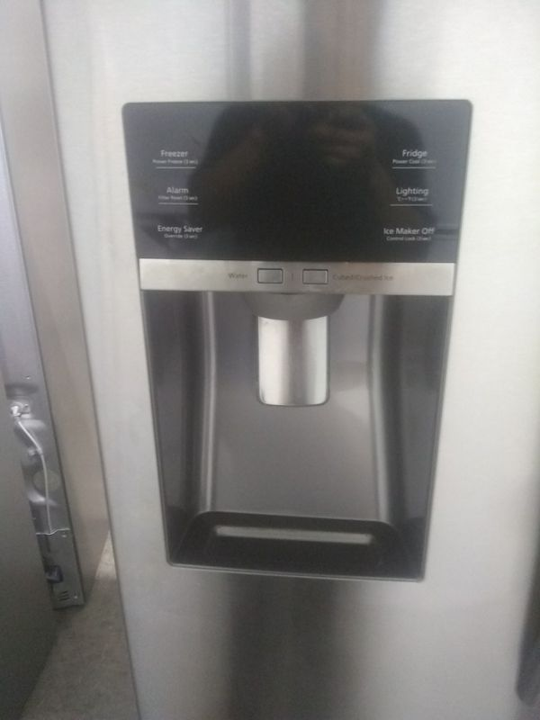 Samsung stainless steel french door refrigerator with water and ice dispenser on the front