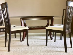 Beautiful Glass top wood dining room table seats 6 people and comes with 6 wooden cushion chairs. Great condition! for Sale in Tampa, FL