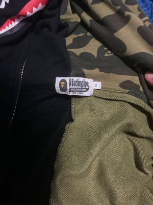Bape jacket barely worn a little rip in the pocket runs small so it's like a large or medium for Sale in Tacoma, WA