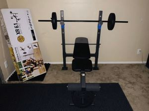 Gold Gym Bench and Bar with weighted plates 50lbs(10s,15s,25s) for Sale in Pasadena, CA